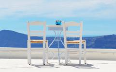 Stock Photo of the chairs on the top of house, santorini island, greece