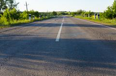 empty rural road go away to distance - stock photo