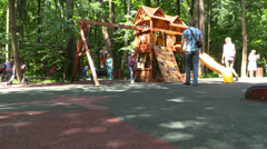 Children play, run and kidding at the PlayGround. Summer Park Activity. Stock Footage