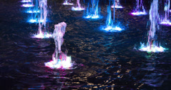 Water fountain with colors changing 4k Stock Footage