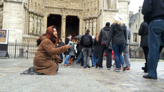 Woman asking for money from people going into Notre Dame Stock Footage