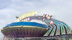 Starship ride at Carnival on sunny day Stock Footage