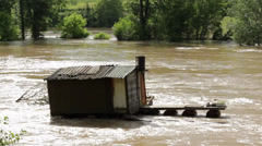 Flooded wooden hut. Damaged cottage after storm and floods. Natural disaster. - stock footage
