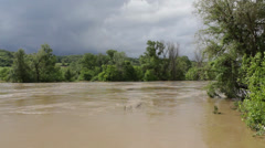 River flooded agricultural fields after big storm. Natural disaster. Cloudy sky. - stock footage