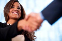 A handshake between business people - stock photo