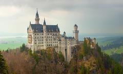 Neuschwanstein castle in Bavarian alps - stock photo