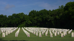 Driving by graves with flags in military cemetery. 4K Stock Footage