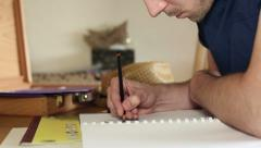 Young artist drawing with a pencil Stock Footage