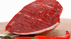 Beef meat chunk on wood with pepper Stock Footage