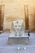 monument with head of pharaoh in luxor temple - stock photo