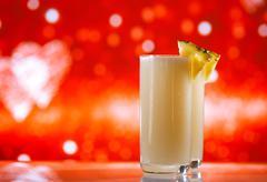 Pinacolada pina colada cocktail glitter red golden background Stock Photos