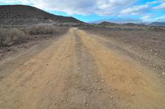Sand and rocks road in the desert Kuvituskuvat
