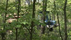 A forwarder transporting the logs from the felling area Stock Footage