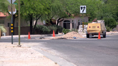 4KUHD road construction hole dig in traffic Stock Footage