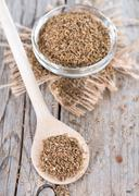 dried aniseed on a wooden spoon - stock photo