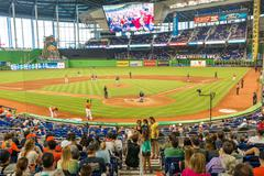 fans watching a baseball game at the miami marlins stadium - stock photo