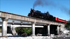 Steam loco crosses river bridge, N.Z. Stock Footage