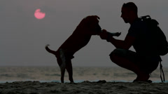The man shakes his paw dog. - stock footage