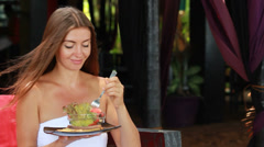 Woman eating vegetables Stock Footage