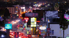Stock Video Footage of Night traffic on the intersection of La Brea Ave and Sunset Blvd in Hollywood