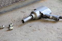 Air gun for change car wheel Stock Photos