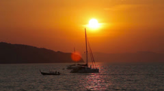 Sailing yacht illuminated by the light of the sun setting Stock Footage