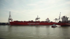 Containership from Hamburg Germany in Rotterdam Harbor the Netherlands Stock Footage