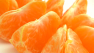 Stock Video Footage of 4K Orange Slices Rotating Closeup