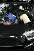 Sport vehicle air filter - muscle car under the hood. Stock Photos