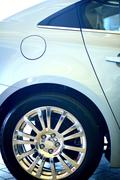 Vehicle side with chrome rim. vehicle closeup. Stock Photos