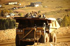 hd mine truck. gold mine and heavy duty truck - stock photo