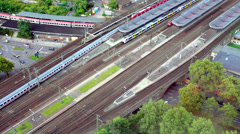 Suburban electric train approaches a railway platform. Stock Footage