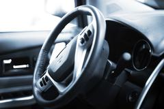 Steering wheel with navigation and sound system operating buttons Stock Photos