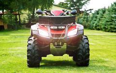 Atv ( all terrain vehicle ) - quad bike on the back yard Stock Photos