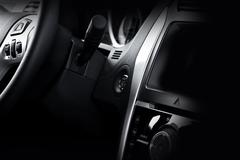Modern vehicle dash and steering wheel. Stock Photos