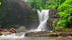 Tegenungan Waterfall it is one of places of interest of Bali - stock footage