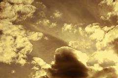 ordinary cloudy sepia sky background. sky above. - stock photo