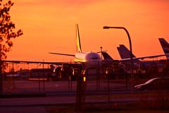 Commercial airliners in sunset. Airport in Sunset Stock Photos