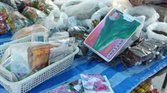 Stall of flower, vegetable and herb seeds at a market in Chiangmai, Thailand. Stock Footage