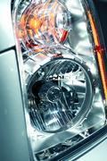 Modern lens car headlight of suv. Stock Photos