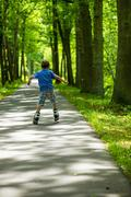 Boy on inline skates, seen from behind Stock Photos