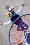 Kids playing a game of basketball Stock Photos