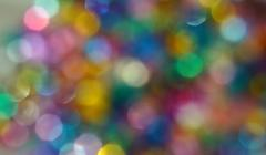 Abstract background of multicolored spots bokeh Stock Photos