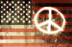 usa flag with the peace sign sprayed on it - stock photo