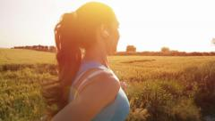 Beautiful Female Model Running Sunset Flare Slow Motion Stock Footage