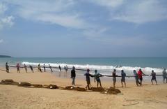Stock Photo of induruwa, sri lanka - 26 apr 2013: sri lankan fishermen pull big net in indur