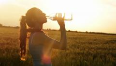 Hot Summer Sunset Woman Drinking Water Tired Runner - stock footage
