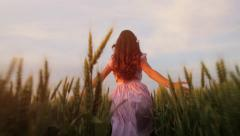 Beautiful Girl Running Through Field at Sunset Slow Motion Stock Footage