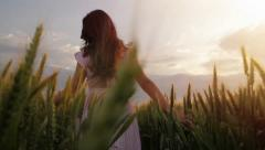 Female Model Vintage Hippy Dress Walking Through Field Sunset Stock Footage