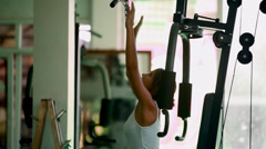 Sports young woman doing exercises on Lat Machine. Stock Footage